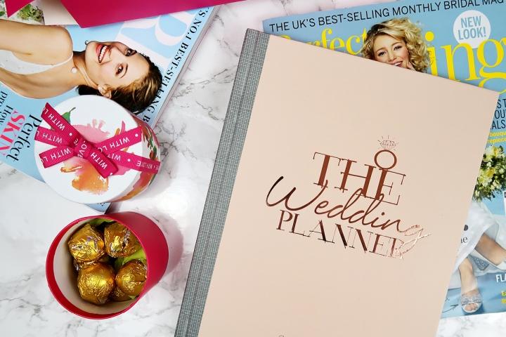 wedding planner flatlay brides magazines